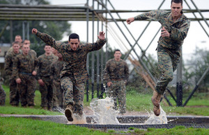 US Marines tackle the Bottom Field assault course at Commando Training Centre Royal Marines Lympstone [Picture: Sergeant Russ Nolan, Crown copyright]