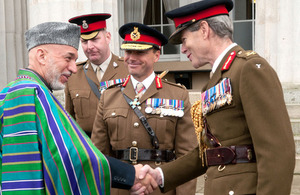 Afghan President Hamid Karzai shakes hands with Lieutenant General Sir Adrian Bradshaw during his visit to the Royal Military Academy Sandhurst [Picture: Mike Smith, Crown copyright]