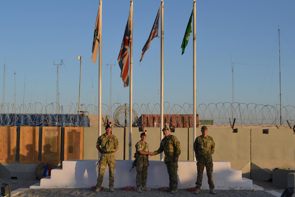 Flag changing ceremony at Main Operating Base Price