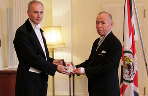 Mr Toji, President of the Kinan International Exchange Association, honoured by The Queen