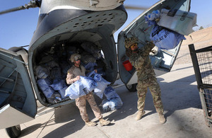 Troops at Camp Bastion in Afghanistan unload bags of Christmas mail from the UK (library image) [Picture: Corporal Mike O'Neill, Crown copyright]