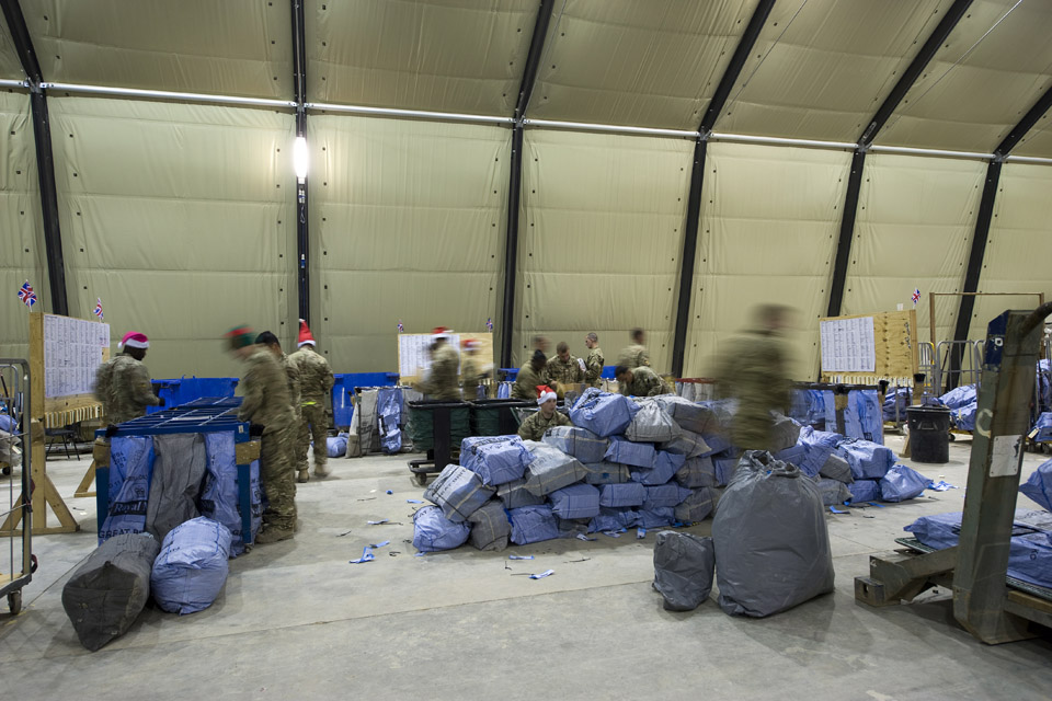 Soldiers sort mail bags