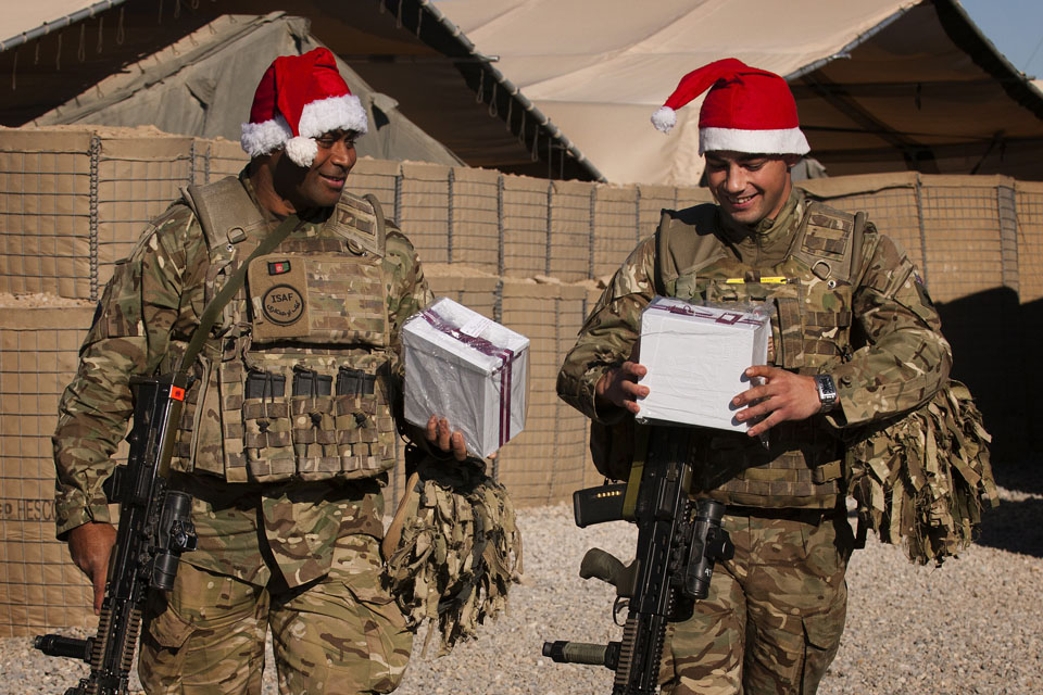 British soldiers with their uk4u Thanks! Christmas boxes