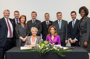 The signing ceremony. Seated (L to R): Linda Pollard, HRH Princess Ghida Talal of Jordan. Standing (L to R): Howard Lyons, Baroness Morris, Dr Geoff Hall, David Berridge, Peter Millet, Dr Asem Mansour, Zaid Bitar, Foluke Ajayi