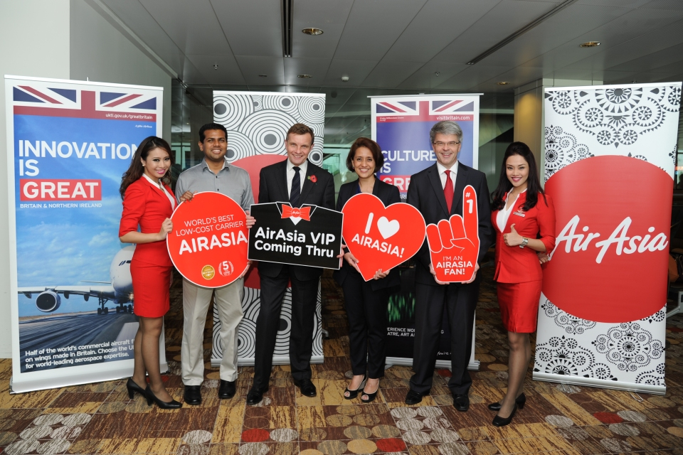 David Jones in Singapore with staff from AirAsia