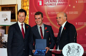 Adam Taylor accepting his award from Nick Clegg and Vince Cable