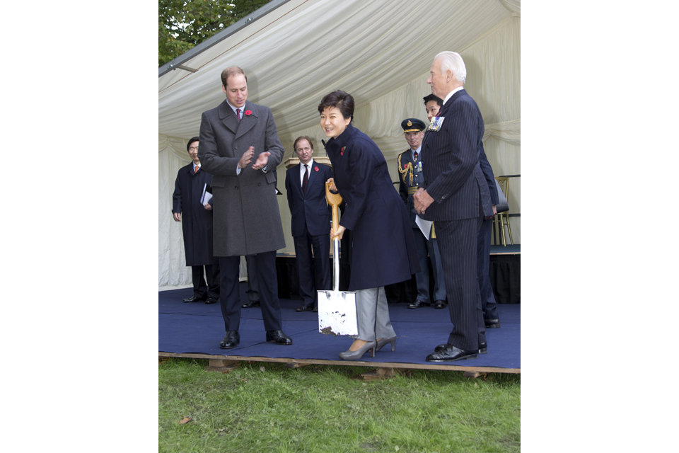 President Park Geun-hye of the Republic of Korea cuts the turf at the site of the new Korean War memorial in London