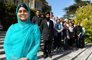 Mandeep Kaur and assembled delegates on the steps of Amport House