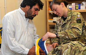 Private Megan Paynter training an Afghan nurse
