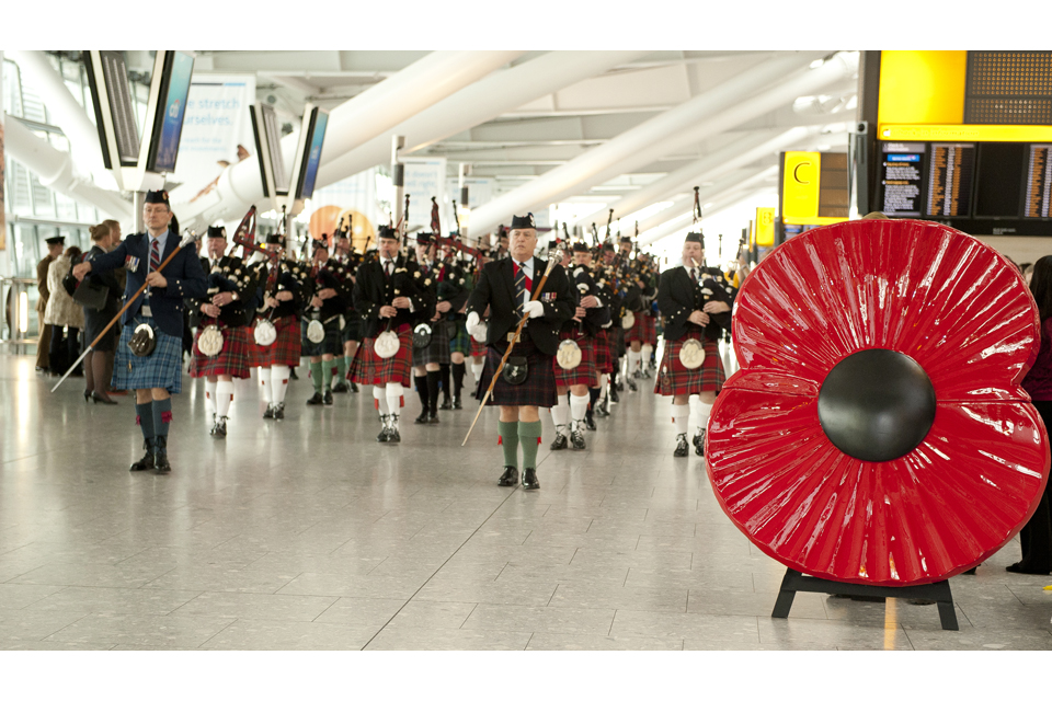 Pipers and drummers at Heathrow Airport