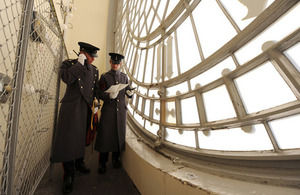 Captain Michael Rose (left) and Staff Sergeant Neal Beer behind one of the clock faces of Big Ben (library image) [Picture: Sergeant Adrian Harlen, Crown copyright]