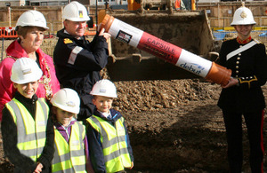 Councillor Lynne Stagg, Commodore Jeremy Rigby, Royal Marines musician April Burrow and local youngsters prepare to bury the time capsule [Picture: Crown copyright]