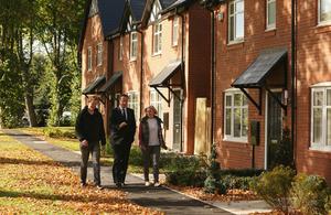 David Cameron is shown around a housing development