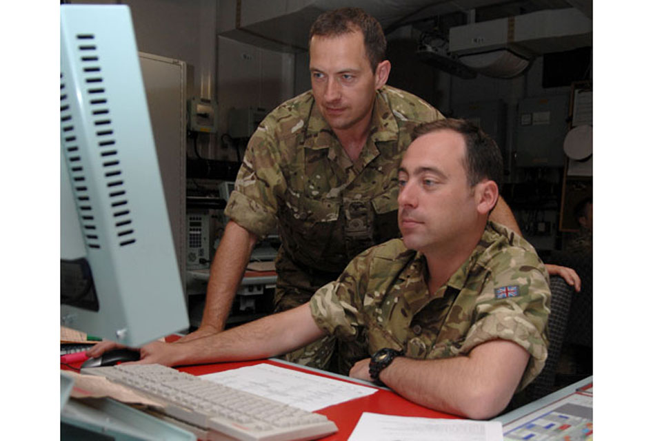 Royal Naval Reservists Lieutenant Richard Turley, from Liverpool's HMS Eaglet (left), and Lieutenant Alec Harper, from London's HMS President (right), support amphibious operations in the Combined Operations Room of assault ship HMS Albion