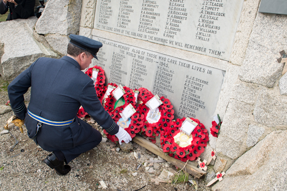 An officer lays a wreath