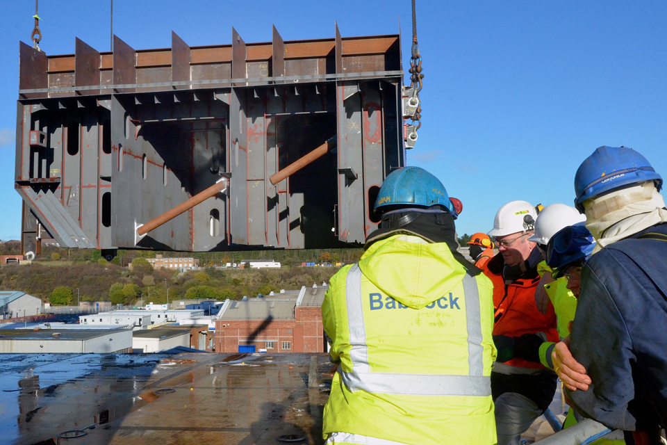The 300-tonne section of ramp is lifted onto the Queen Elizabeth