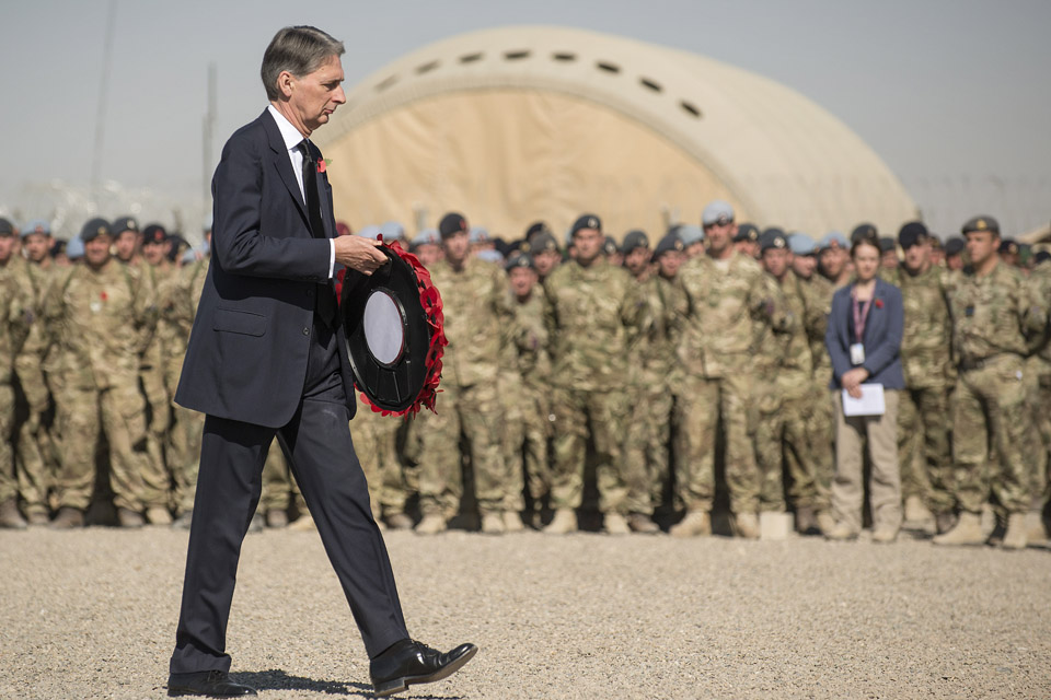 The Defence Secretary lays a wreath during the remembrance service held at Camp Bastion