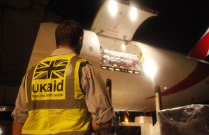 UK aid worker Alex Franklin supervises unloading of humanitarian supplies at Cebu airport. Picture: Simon Davis/DFID