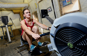 Captain Heather Stanning training on a rowing machine at Camp Bastion, Afghanistan (library image) [Picture: Sergeant Dan Bardsley, Crown copyright]