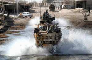 Members of 3rd Battalion The Parachute Regiment splash through a ford