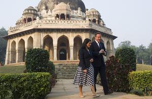 David Cameron walks with Priti Patel through the Lodhi Gardens in Delhi.