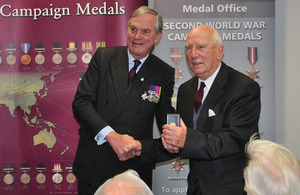 Lord Astor of Hever (left) presents an award to a Second World War veteran [Picture: Crown copyright]