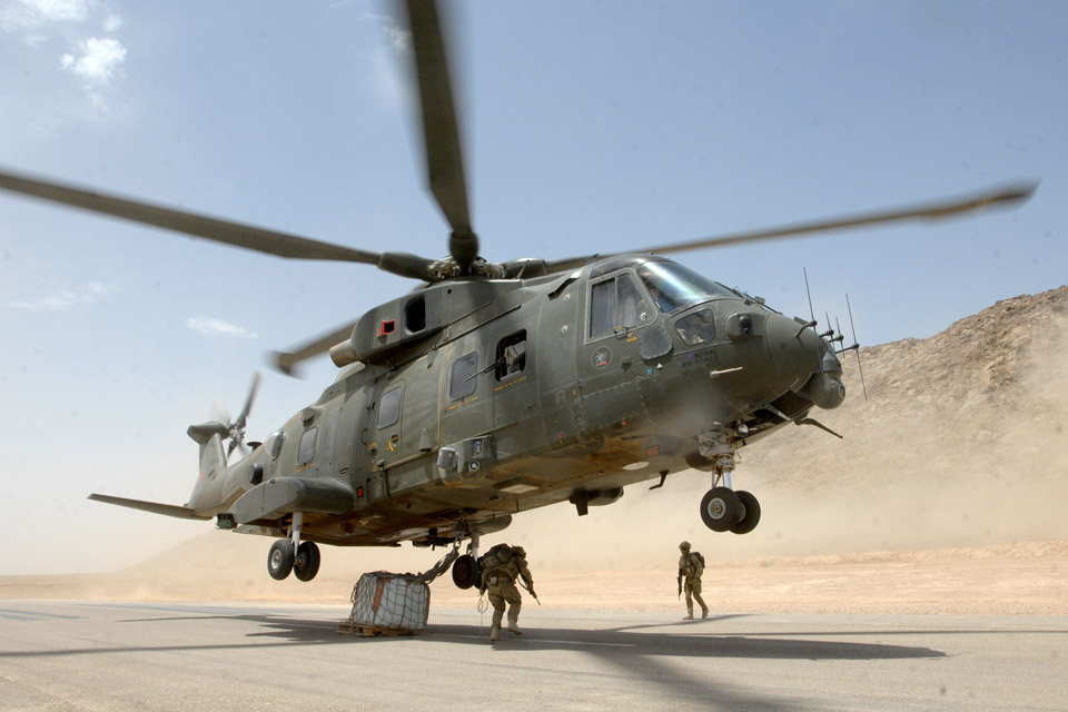 An RAF Merlin helicopter takes off with an underslung load in Afghanistan
