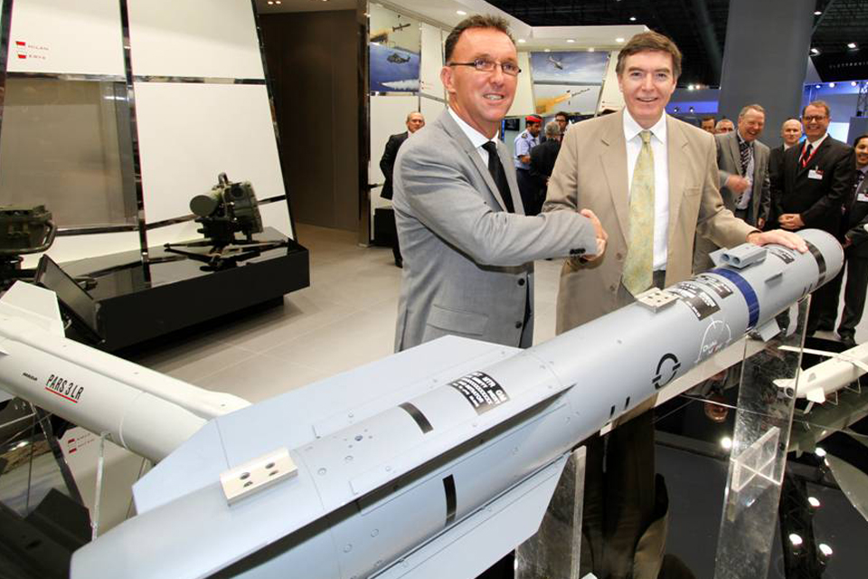 Philip Dunne (right) with a Brimstone missile