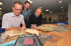 Record reviewers (from left to right) Grant Hodgkins, Stephen Searle and Carl Basson with some Second World War RAF casualty packs [Picture: Petty Officer Airman (Photographer) Owen Cooban, Crown copyright]
