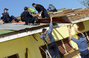 Members of HMS Daring's crew repairing the Hagdan school's roof [Picture: Leading Airman (Photographer) Keith Morgan, Crown copyright]