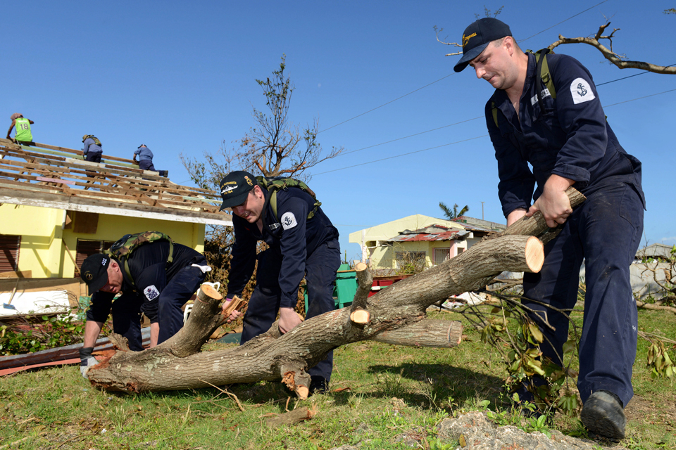 Members of HMS Daring's crew clearing debris