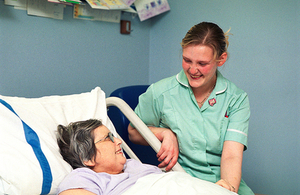 Nurse smiling with patient