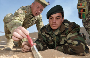 Sergeant David Thomson teaching an Afghan soldier counter-IED techniques