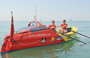 Captains Hamish Reid and Nick Dennison in their ocean-going rowing boat 'Komale'