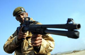 A soldier displays the new combat shotgun