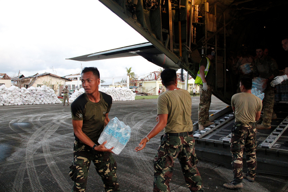 Humanitarian relief supplies are unloaded from an RAF C-130 aircraft