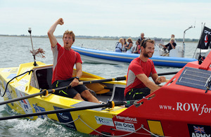 Captains Hamish Reid and Nick Dennison cross the finish line in the Solent