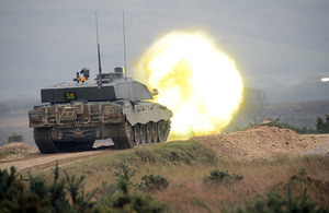 A white-hot round is fired from a Challenger 2 tank's gun [Picture: Sergeant Russ Nolan, Crown copyright]