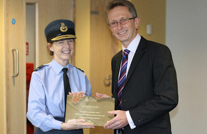 Air Vice-Marshal Elaine West receives a commemorative plaque from Graham Jeffery, Debut Services Head of Defence Frameworks [Picture: Crown copyright]