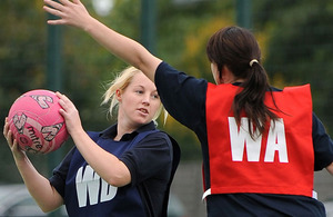 Private Kerry Smith (with the ball) competes at the British Army (Germany) Inter Unit Netball Competition
