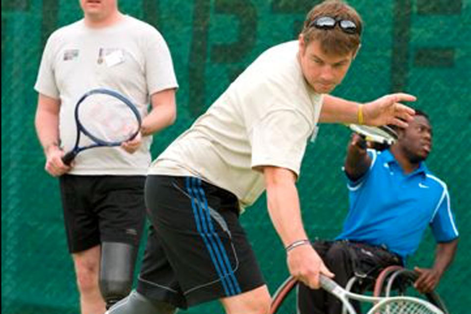 An injured serviceman playing tennis at the launch of the Battle Back tennis initiative