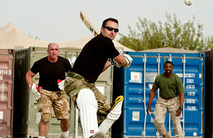A Royal Marine prepares to hit the ball for six in Sangin