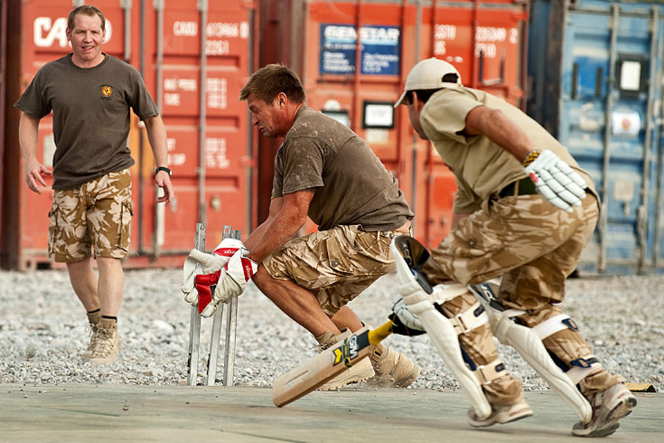 British and US Marines take part in a charity cricket match at Forward Operating Base Jackson in Sangin