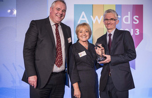 Mark Lowcock receives the most improved government body award from Margaret Hodge and Richard Bacon (Chair and Deputy Chair of the Public Accounts Committee).