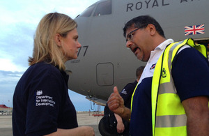 Justine Greening is greeted by UK Ambassador to the Philippines Asif Ahmad at Cebu airport during a visit to see how the UK is helping those affected by Typhoon Haiyan. Picture: Russell Watkins/DFID