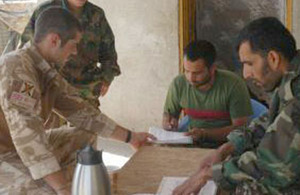 Lieutenant David Duffus puts his Dari language skills to good use as an adviser to the Afghan National Army