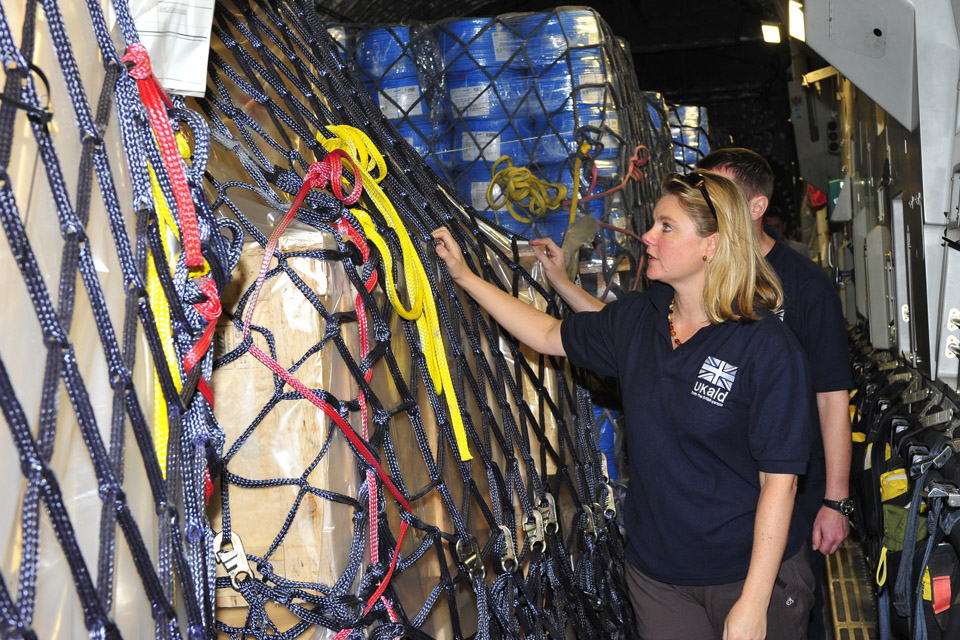 Justine Greening inspects aid supplies on board the C-17