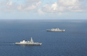 HMS Daring (front) and HMS Illustrious [Picture: Leading Airman (Photographer) Nicky Wilson, Crown copyright]