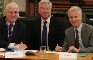 Lord Deighton and Michael Fallon signing the initiative with Chris Newsome from Anglia water