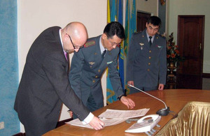 UK MOD representative Mr Derek Sturge signs the Military Cooperation Plan for 2014 with Lieutenant Colonel Nurmashev in the Kazakh MOD